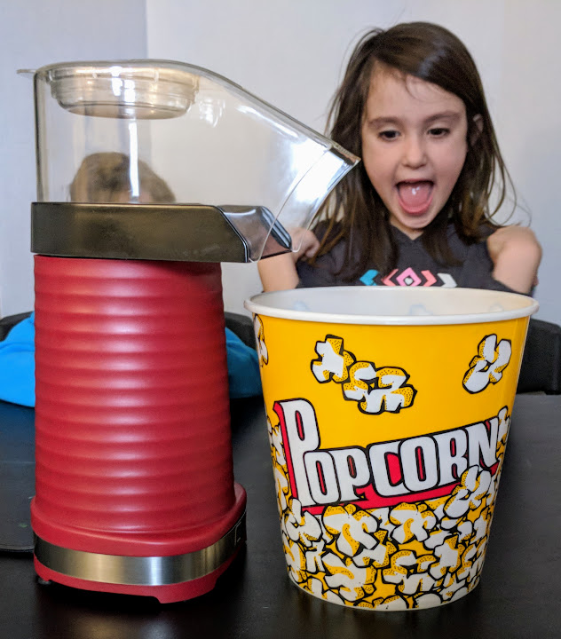 Making popcorn for family movie night