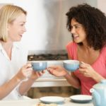 Two women having an openhearted conversation over a cup of tea.