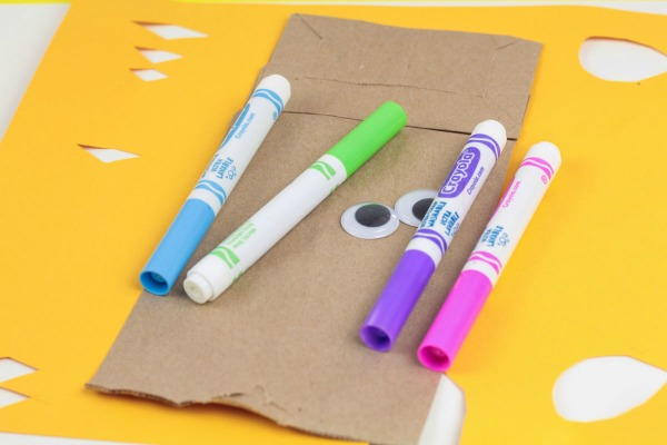 Craft supplies to make a paper bag unicorn.