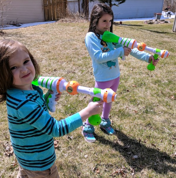 My kids holding Slime Blaster guns, ready to play outside.