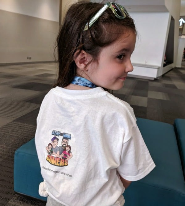 My daughter wearing our Stay At Home Gamers t shirt at Origins Game Fair.