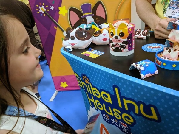 My daughter learning how to play Circus Puppy at Origins Game Fair