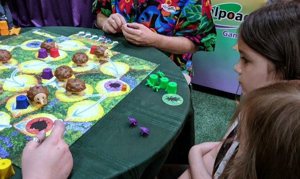 My kids learning how to play Echidna Shuffle at Origins.