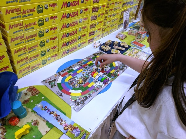 My daughter looking at the Monza demo game at HABA's booth.