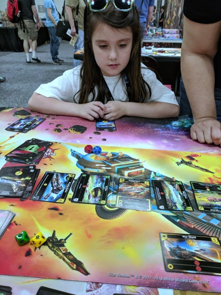 Playing Star Realms with my daughter at Origins.