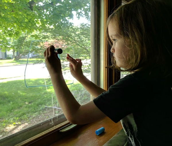 Preschool writing practice on the window