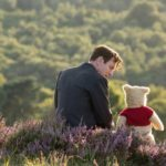 Christopher Robin and Winnie the Pooh sitting together outside