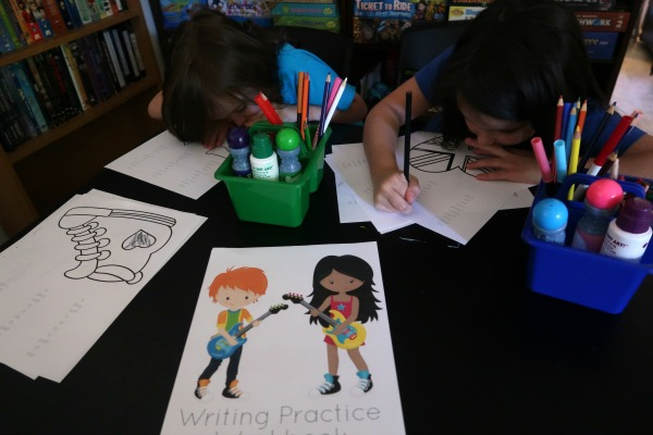 My kids practicing writing skills using the sight words printable sheets during our at home writing center.