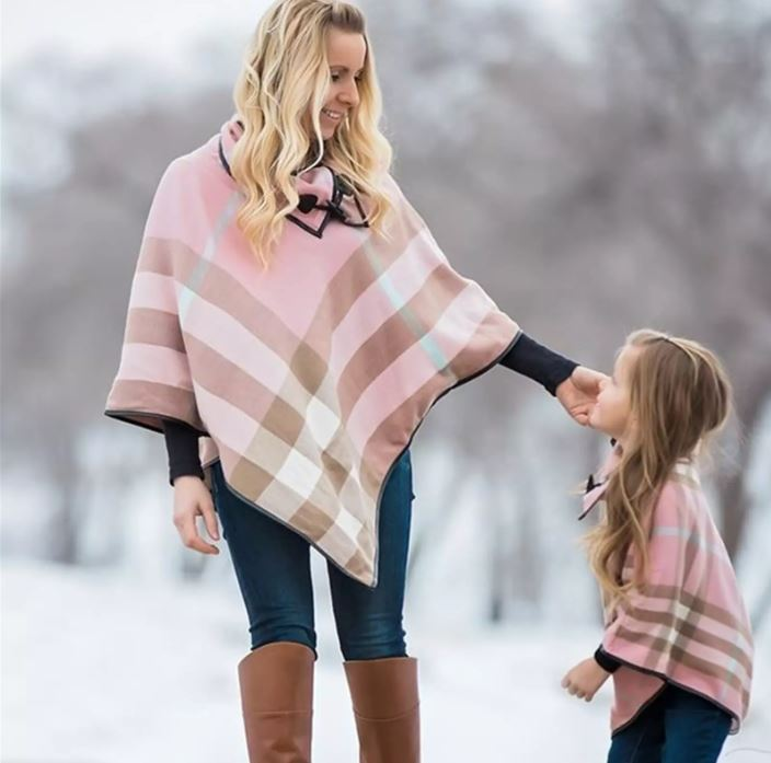 Matching plaid ponchos for mom and daughter