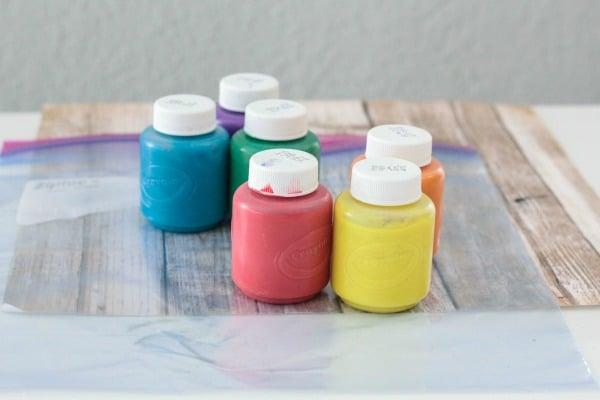 Supplies you need to make a rainbow writing bag for kids.