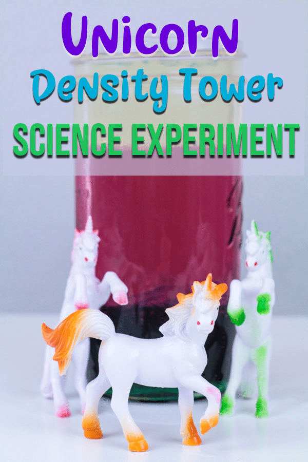 Jar with liquid layers of different colors and unicorn figures for density tower experiment.