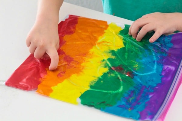Kids can trace letters, numbers, and draw with this mess-free rainbow bag of paint.