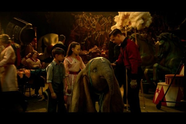 Dumbo movie still of Dumbo with children and Holt Farrier at the circus.