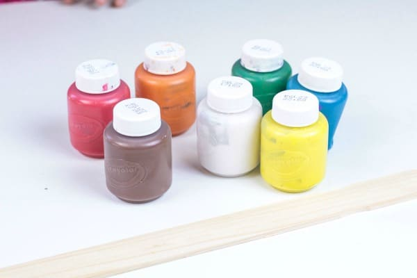 Assorted paint colors and paint stick for the fingerprint solar system activity.
