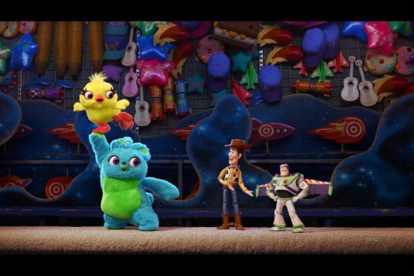 Bunny, Ducky, Woody, and Buzz at the carnival in Toy Story 4
