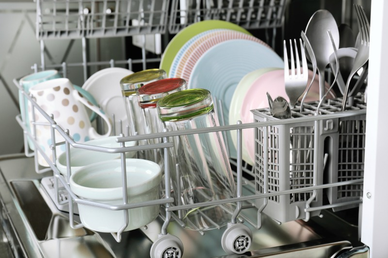 Clean glasses and dishes in dishwasher