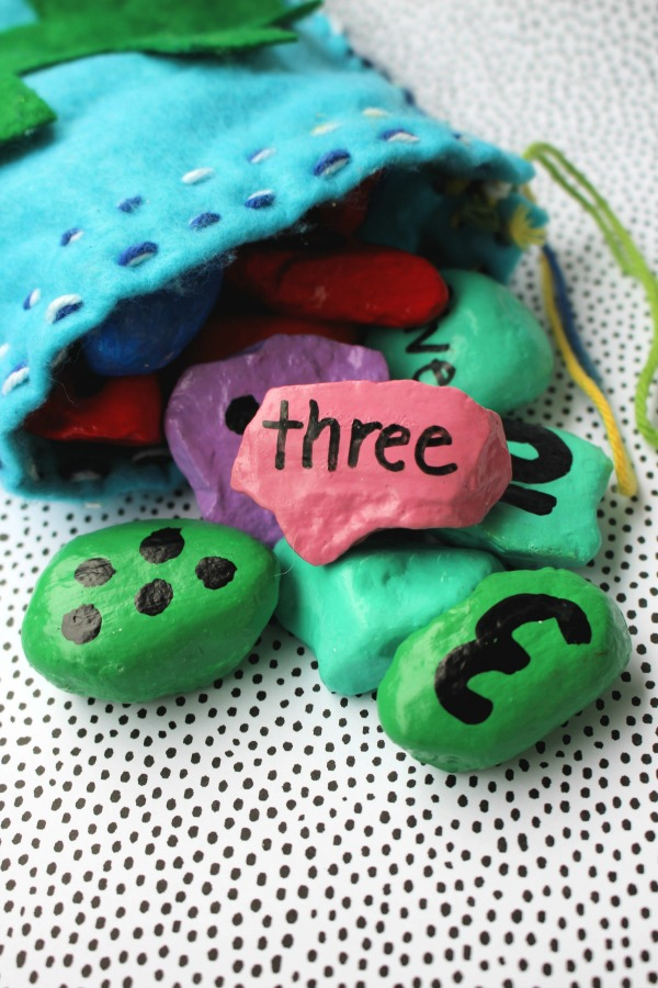 Completed number rocks spilling out of felt bag
