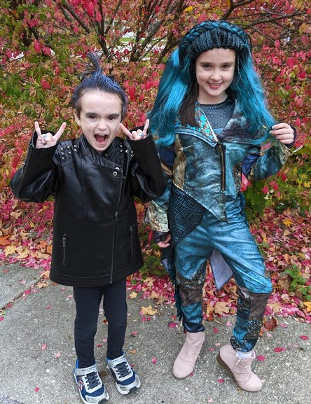 Boy dressed up as Hades and girl dressed up as Uma characters from Descendants 3 movie.