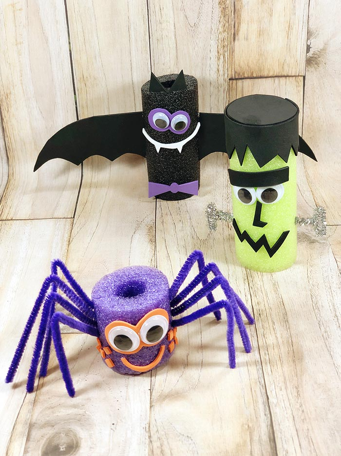 Completed spider, bat, and Frankenstein Halloween decorations made out of pool noodles
