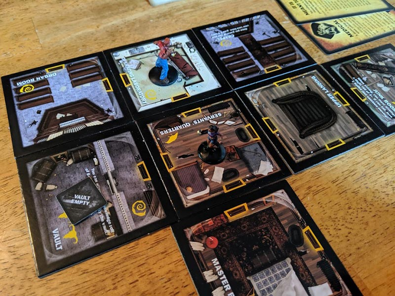 Room cards on table for playing Betrayal at House on the Hill.
