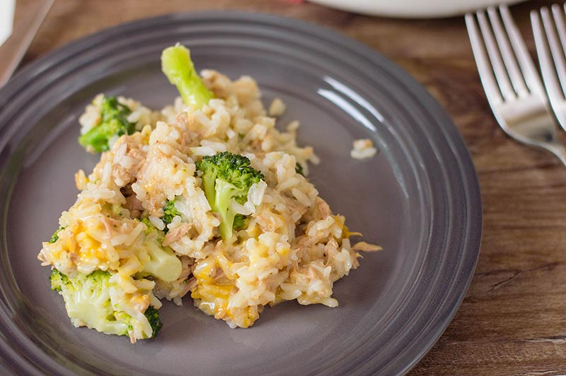 Tuna and rice with cheese and broccoli served on gray plate