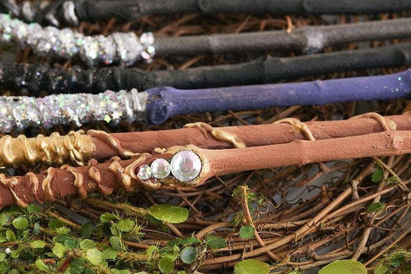 Close up of finished wand craft to show detail on the handle and added gems.
