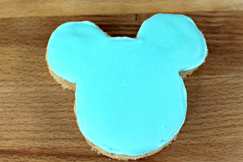 Mickey Ears shaped rice crispy treat with light blue icing covering the top.