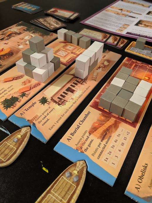 Playing Imhotep board game.