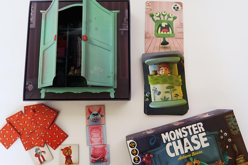 Monster Chase board game for kids game pieces on table.