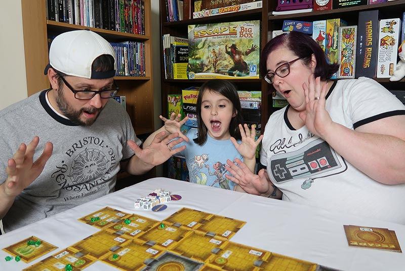 Family playing Escape Curse of the Temple board game.