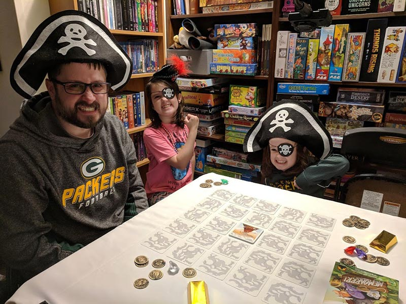 Family dressed as pirates playing Memoarrr game.