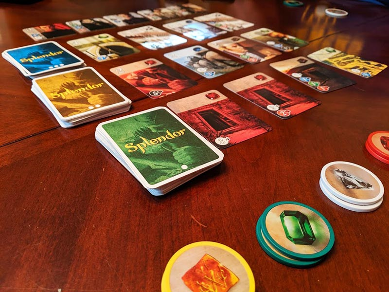 Splendor game set up on table.