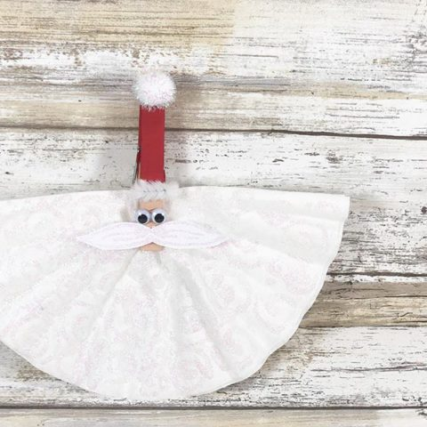 Finished Santa craft made with coffee filter and clothespin.