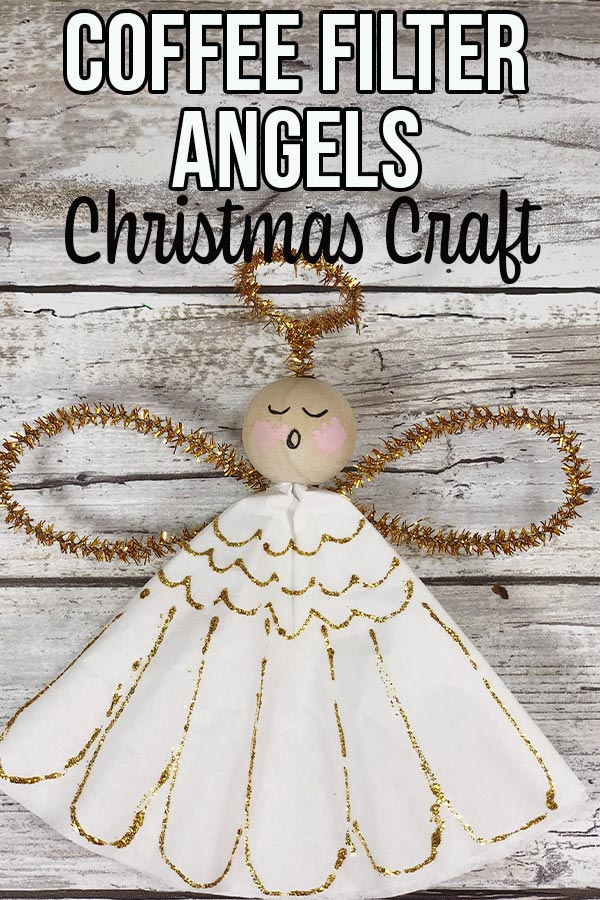 Close up of one completed coffee filter angel with painted face. Text overlay describes project.