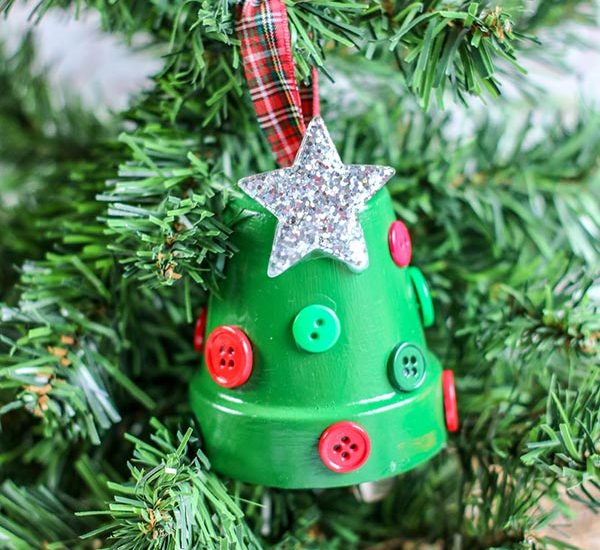 Completed Christmas tree flower pot ornament hanging from small Christmas tree.