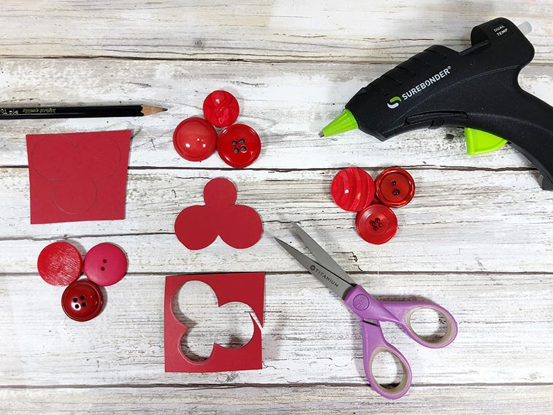 Craft tutorial showing steps for tracing buttons on red card stock paper and gluing them.