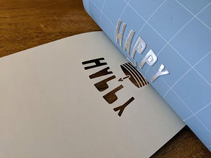 Peeling blue LightGrip cutting mat off of paper.