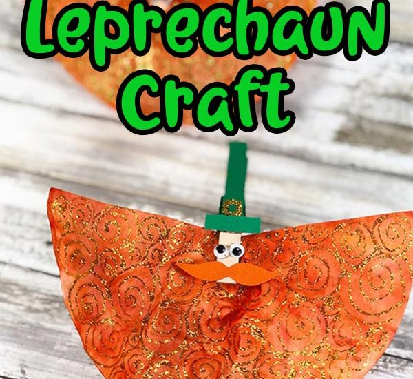 Woman's hand holding finished leprechaun craft and another laying in background. Text overlay with craft title.