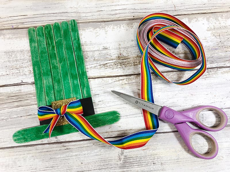Rainbow striped ribbon tied in a bow and added to leprechaun hat.