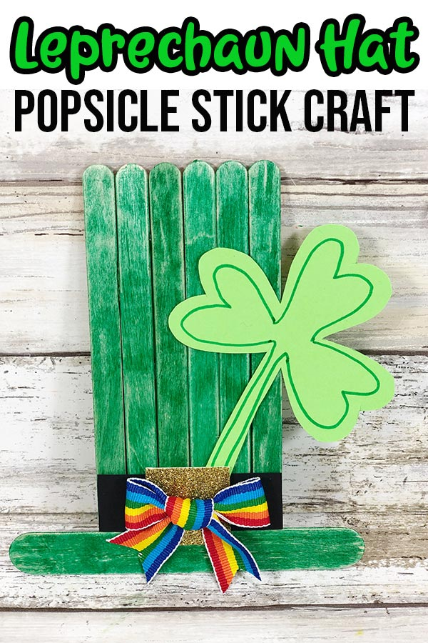 Completed leprechaun hat popsicle stick craft with text overlay.