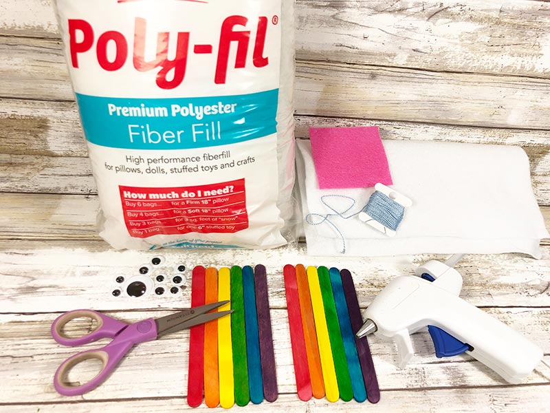 A bag of poly-fil, colored popsicle sticks, googly eyes, felt, scissors, and glue gun.
