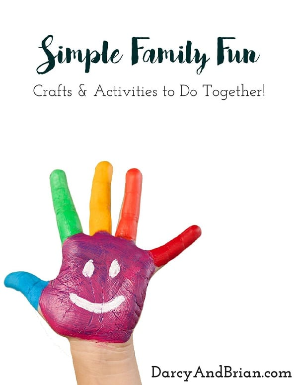 Preview of ebook cover. White background with black text that says Simple Family Fun Crafts & Activities to Do Together! And a child's hand covered in colorful paint with a smiley face on their palm.