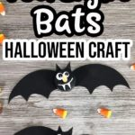 Two completed bats made with black flameless tea light candles on a gray wooden background with candy corn sprinkled around them. Text at top says Tea Light Bats Halloween Craft