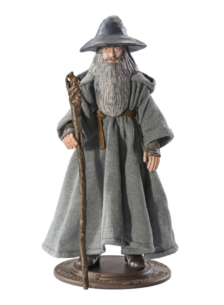 Gandalf posable figure in gray hat and robes holding staff and on stand base with white background.