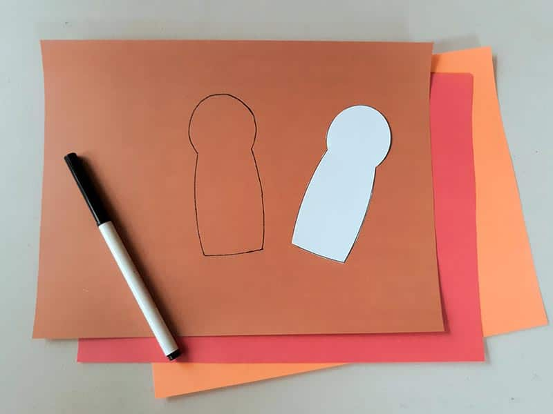 Used turkey body template to trace shape onto brown construction paper.
