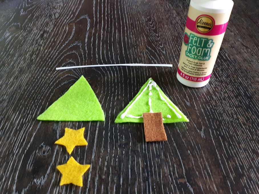 Felt Christmas tree craft tutorial step showing where to glue the stump on the triangle.