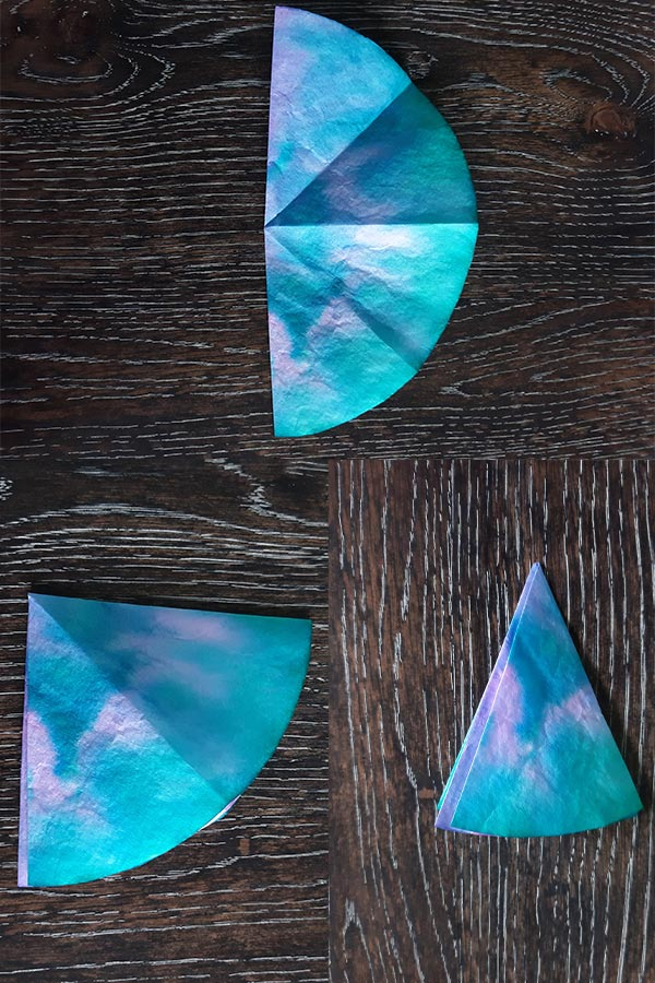 Three image collage demonstrating how to fold the coffee filter for this craft tutorial.