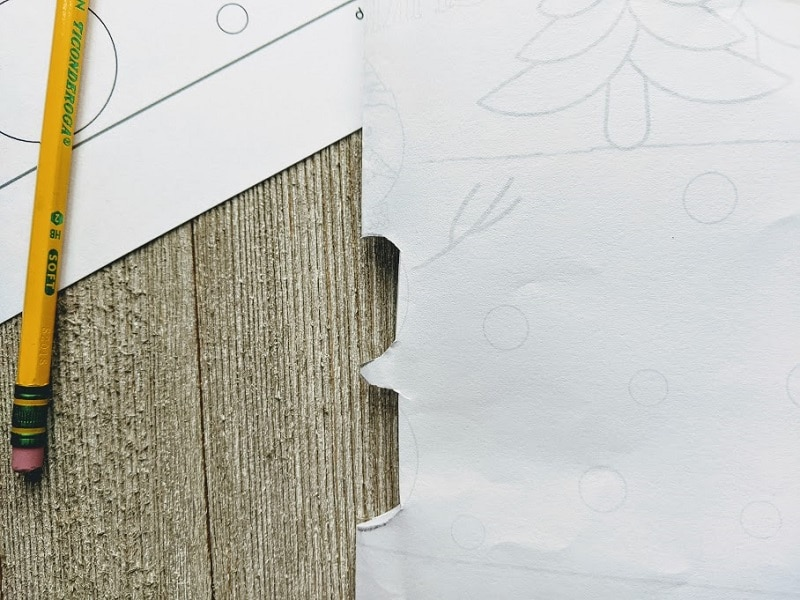 Printable snowman card folded in half with two parts of snowman's body folded inward at crease.