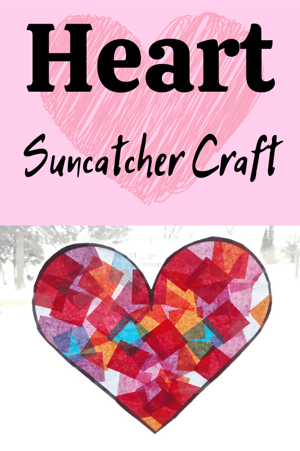 Black text on pink background with faded red heart reads Heart Suncatcher Craft above photo of completed heart shaped suncatcher made with tissue paper in brightly lit window.