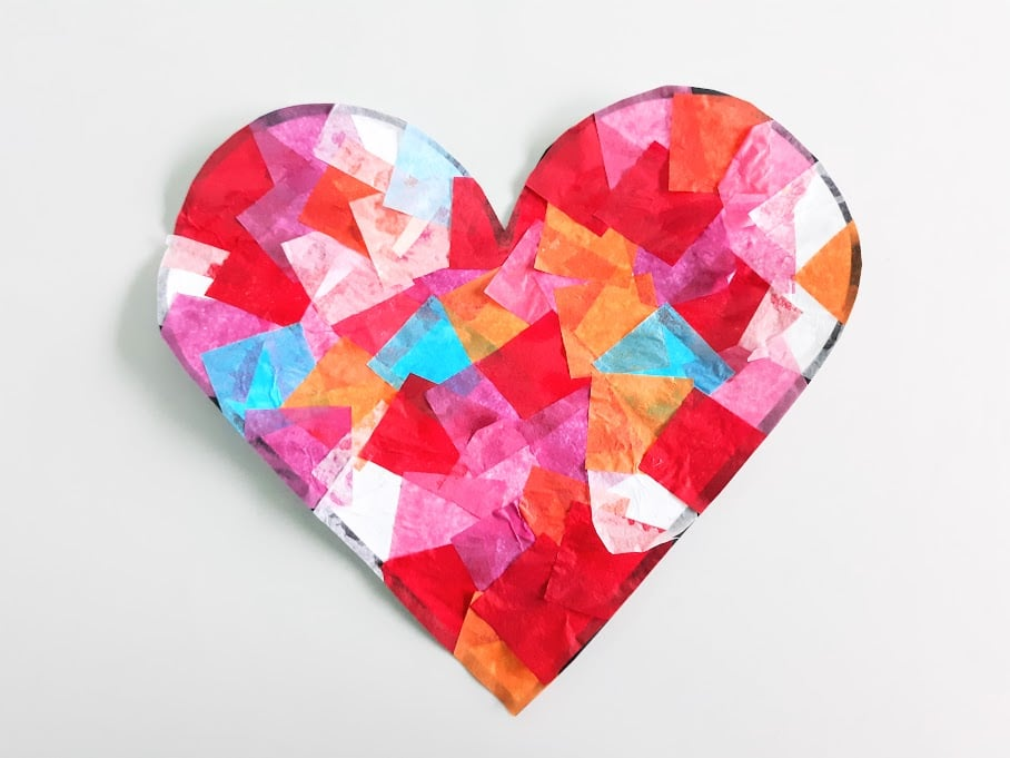 Heart shaped tissue paper suncatcher cut out from printable template.